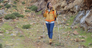 Fit healthy young woman hiking on a trail Stock Images