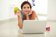 Fit hispanic woman using her laptop Stock Photography