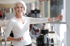 Fit inspired woman doing exercise. Stock Image