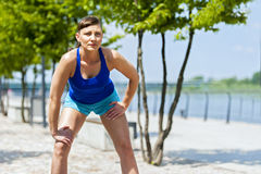 Fit jogger woman resting after run in city park. Royalty Free Stock Photos