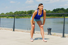 Fit jogger woman resting after run in city park. Royalty Free Stock Photography
