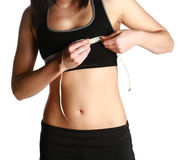 Fit lady measuring her bust Stock Image