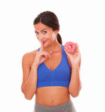 Fit lady secretly eating sugary food Stock Photos