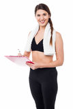 Fit lady trainer preparing diet chart Stock Photos