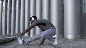 Fit latin man stretching muscles in slow-motion, healthy individual working out. Stock footage stock video