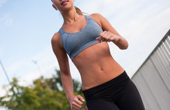 Fit lean blond beauty. Fit lean blond beauty exercising outdoors in the city Royalty Free Stock Images