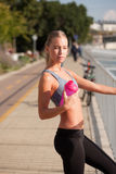 Fit lean blond beauty. Fit lean blond beauty exercising outdoors in the city Stock Photography