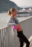 Fit lean blond beauty. Fit lean blond beauty exercising outdoors in the city Stock Images