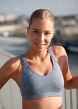 Fit lean blond beauty. Fit lean blond beauty exercising outdoors in the city Royalty Free Stock Photography
