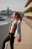 Fit lean blond beauty. Fit lean blond beauty exercising outdoors in the city Stock Photos