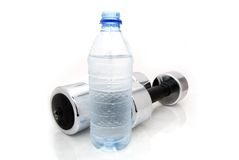 Fit for life. Bottle water and weights on white Stock Images