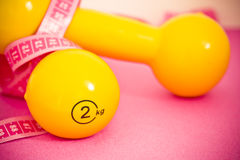 Fit life: dumbbells, measuring tape and apple Stock Images