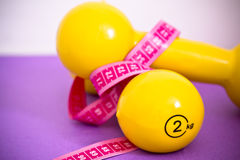 Fit life: set of dumbbells and measuring tape Royalty Free Stock Photography