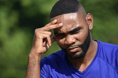Fit Male Athlete Thinking. A handsome adult black man Stock Photos