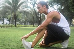 Fit male model exercising outside. stock images