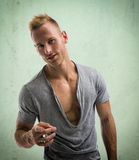 Fit male model smiling and pointing finger to camera Stock Photo