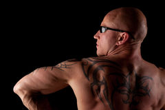 Fit Male Model With Tattoos. Fit Bodybuilder With Sunglasses On Black Isolated Background Stock Image