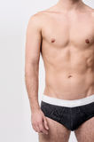 Fit male posing in underwear. Cropped image of healthy male in underwear Royalty Free Stock Photo