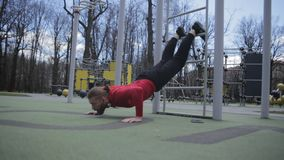 Fit man with beard at workout outdoors. Doing push ups. Exercise for upper pecs stock video