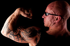 Fit Man On Black Background. Fit Bodybuilder With Sunglasses On Black Isolated Background Royalty Free Stock Photography