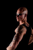 Fit Man On Black Background. Fit Bodybuilder With Sunglasses On Black Isolated Background Royalty Free Stock Images