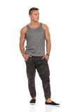 Fit Man In Camo Pants Standing With Hands In Pocket Royalty Free Stock Photography