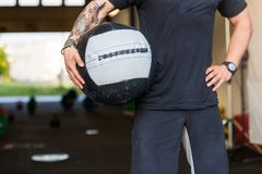Fit Man Carrying Medicine Ball Stock Images