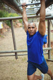 Fit man climbing monkey bars Royalty Free Stock Photo