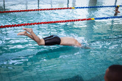 Fit man diving in the water Stock Photos