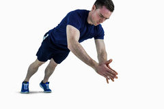 A fit man doing clapping hands push ups Stock Photos