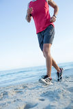 Fit man doing jogging Royalty Free Stock Photos