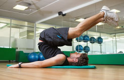 Fit man doing pilates in fitness studio Royalty Free Stock Photography
