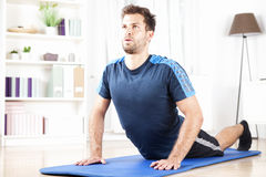 Fit Man Doing Press Up Exercise on a Fitness Mat Stock Images