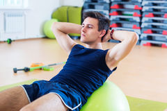 Fit Man Exercising With Fit Ball Workout Out Arms Exercise ...