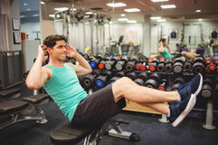 Fit man doing sit ups. At the gym Royalty Free Stock Photo