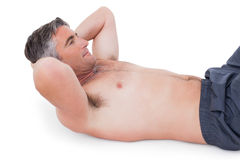 Fit man doing sit ups with no shirt on Royalty Free Stock Photos