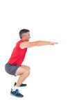 Fit man doing a squat Royalty Free Stock Photo