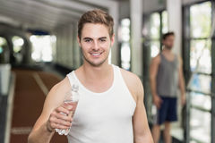 Fit man drinking water Royalty Free Stock Images