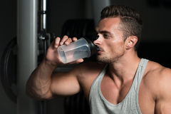 Fit Man Drinking Water Royalty Free Stock Photos