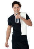 Fit man drinking water isolated on white Stock Images