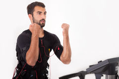 Fit man exercise on  electro muscular stimulation machine Royalty Free Stock Photos