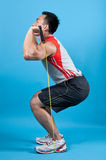 Fit man with exercise stretch band Royalty Free Stock Images