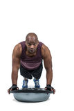 Fit man exercising with bosu ball Royalty Free Stock Images