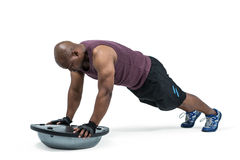 Fit man exercising with bosu ball Royalty Free Stock Image