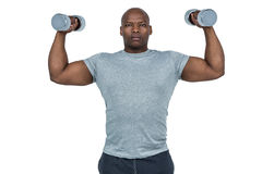 Fit man exercising with dumbbell Royalty Free Stock Images