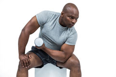 Fit man exercising with dumbbell Stock Photography