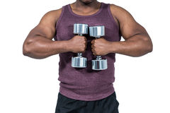 Fit man exercising with dumbbell Stock Photo
