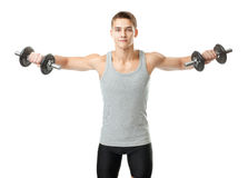 Fit man exercising with dumbbells Stock Image