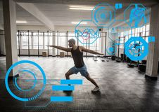 Fit man exercising in gym with  futuristic interface Stock Image