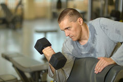 Fit man exercising at gym Stock Photo